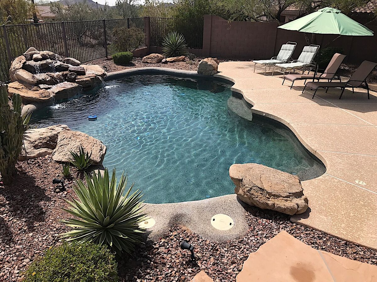 Heated Pool with water feature