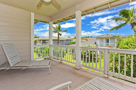 Upper balcony of this condo for rent in Ko Olina Hawaii, with porch chairs.