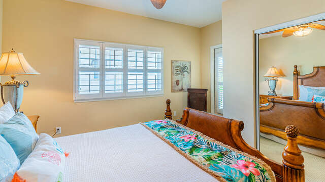 Second Bedroom has a closet with mirrored doors and access to a small lanai