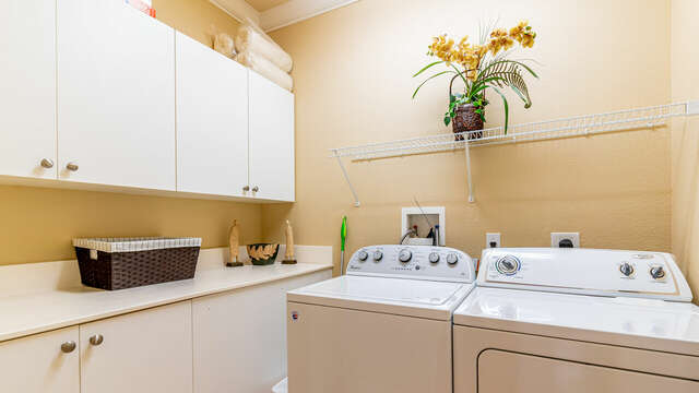 Laundry room with washer, dryer, and cabinetry.