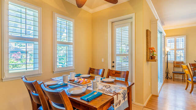 Dining area by the door to the back yard, with small table and chairs.
