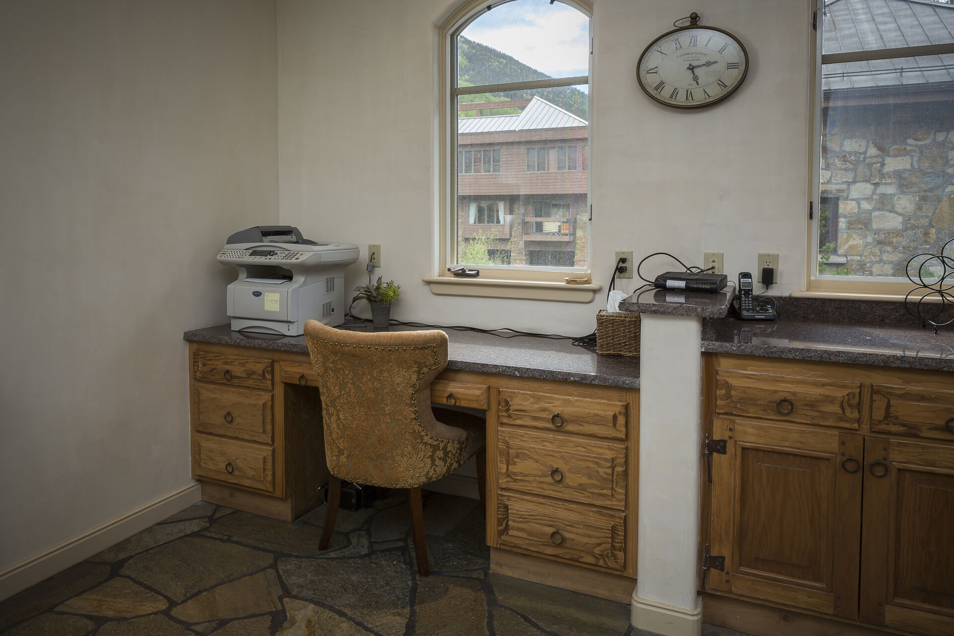 The office area of this rental, with printer and great views.