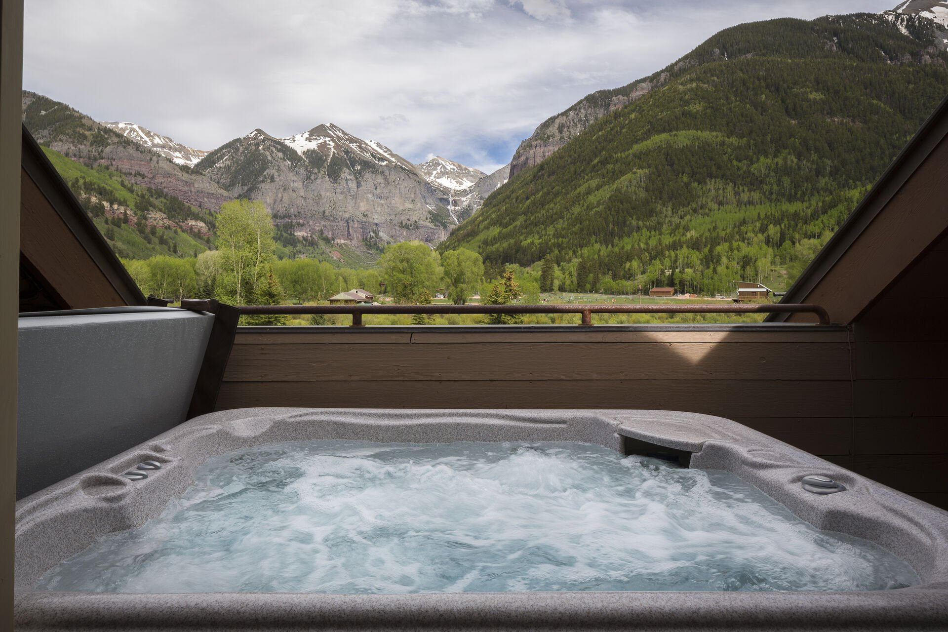The private hot tub of this Colorado Mountain vacation rental, with views out onto the mountains.