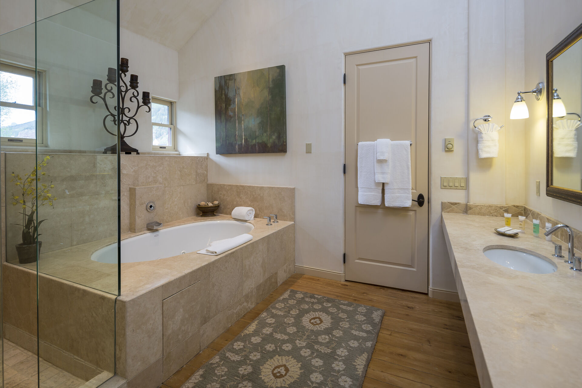 Bathroom of this Colorado Mountain vacation rental, with walk-in shower, a spa tub, and vanity sink.