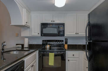 Quality appliances and granite counters are highlights.