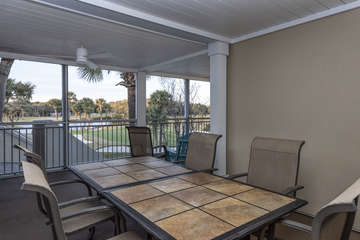 sliding doors lead to the covered porch where there is a table for 6.
