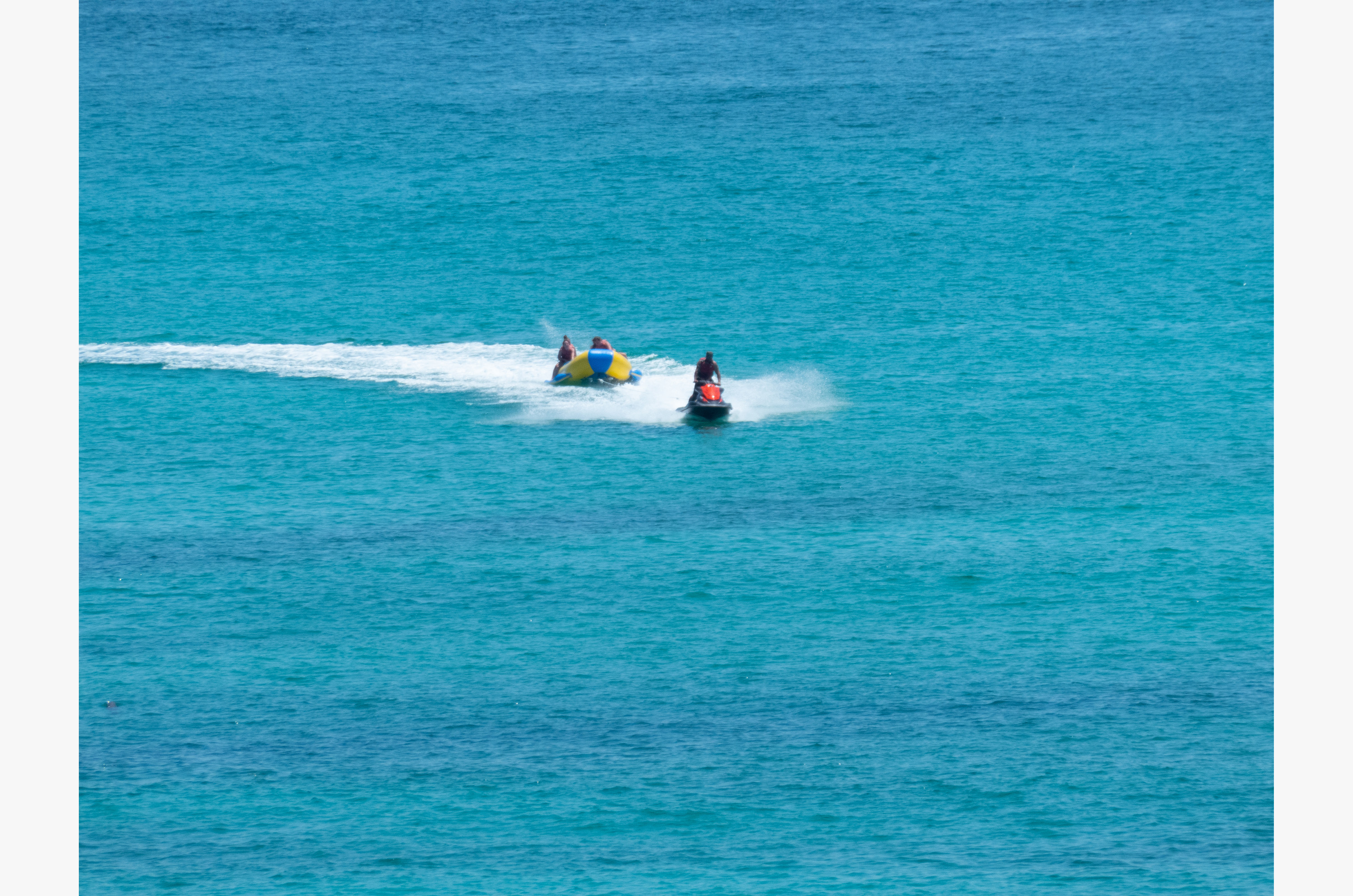 Rent a Jet Ski or take a banana boat ride.  Check with the beach kiosk for schedules and pricing.  They also have beach chairs and umbrellas for rent by the day or by the week.