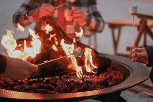 Book a beach bonfire for a special evening.