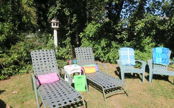 Read, watch the birds, or take a nap. You will certainly unwind and relax in the back yard - 14 Capri Lane Chatham Cape Cod New England Vacation Rentals