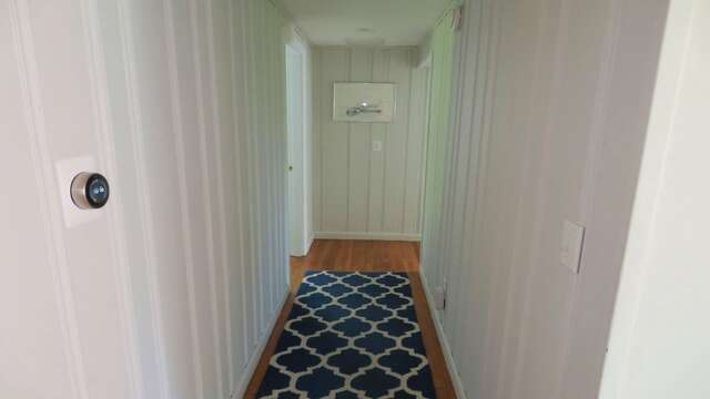 HEad down the hall on the main floor to find the full bath and 3 bedrooms - 14 Capri Lane Chatham Cape Cod New England Vacation Rentals