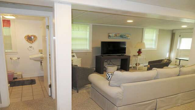 Lower level with Queen sleep sofa, TV, and small ping pong table, and an AC There is also a washer and dryer on this level too! - 14 Capri Lane Chatham Cape Cod New England Vacation Rentals