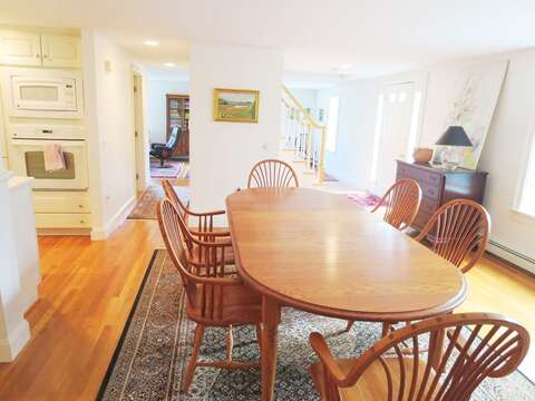 Open dining has large table to share family meals - 1789 Main Street Chatham Cape Cod New England Vacation Rentals