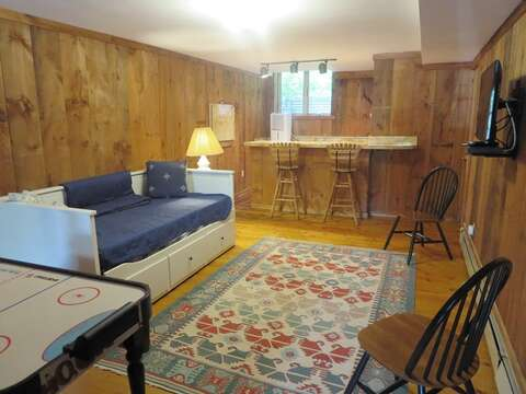 Lower level game room with flat screen TV and trundle bed (sleeps 2) - 1789 Main Street Chatham Cape Cod New England Vacation Rentals