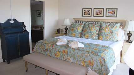 It features a king bed and en suite bathroom.