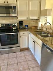 New stainless steel appliances compliment the kitchen!