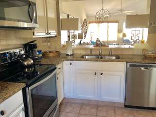 New stainless steel appliances have been added! Features include a tumbled marble tile backsplash and granite counters.
