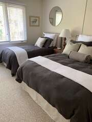 Off the hall is a bedroom that sleeps 3. It has a queen bed and a twin bed with duvets and down comforters.
