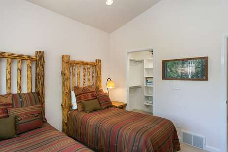 Main Level with Twin Beds and View of Walk In Closet