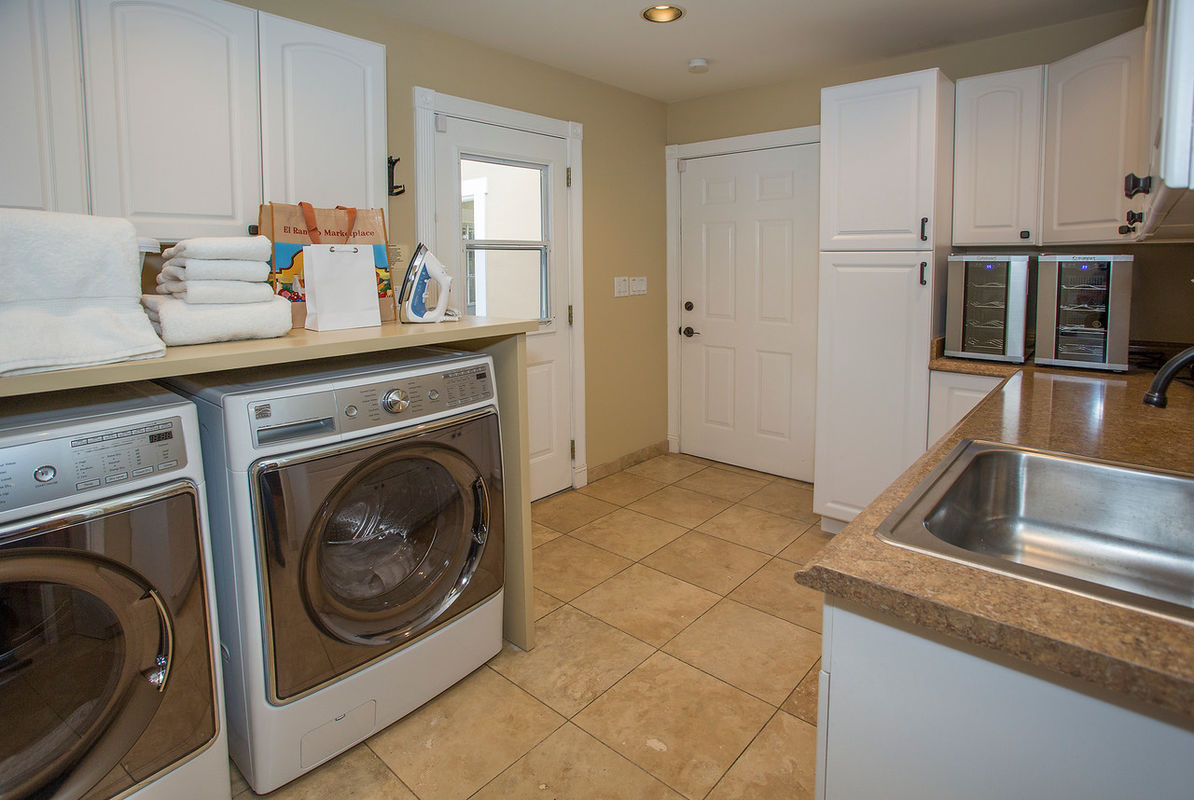 Efficient Laundry Room with wine coolers!