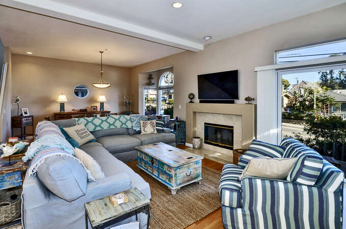 Living room with full views of Twin Lakes Beach.