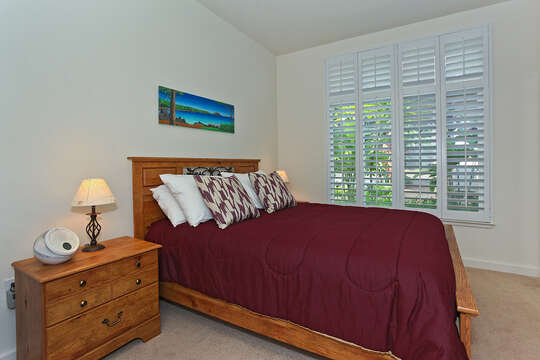 Bedroom Features Plenty of Natural Light Coming in From Windows.