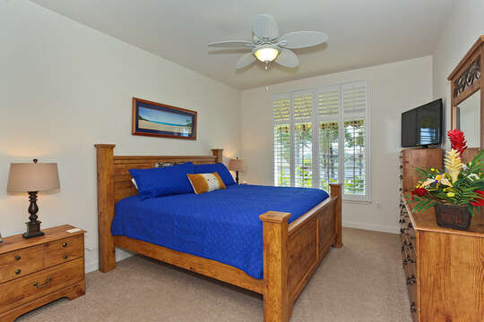 Master Bedroom in Ko Olina Kai Golf Estate with Wooden Furniture.