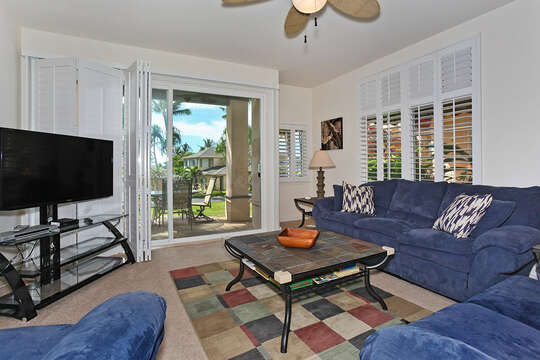Living Area of this Ko Olina condo in Hawaii, Complete with Blue Couches.
