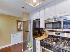 Kitchen has stainless steel appliances.