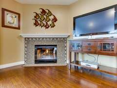 Spacious Living with fireplace and HD TV, cable and WiFi.