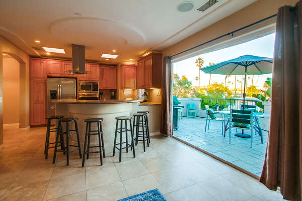 Open Doors to the Patio, Kitchen, and Stools.