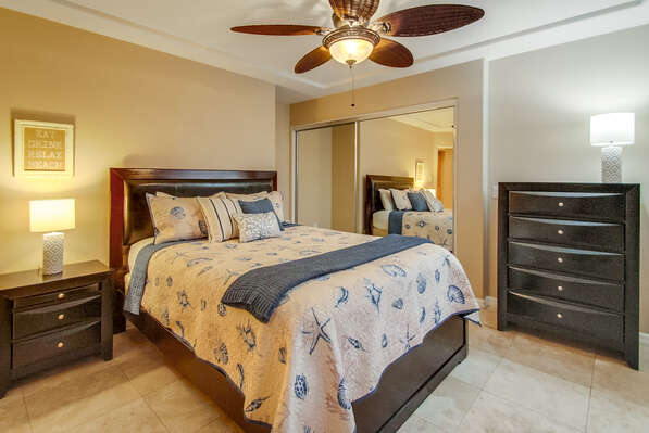 Large Bed, Dresser, Closet, Nightstand, Table Lamps, and Ceiling Fan.