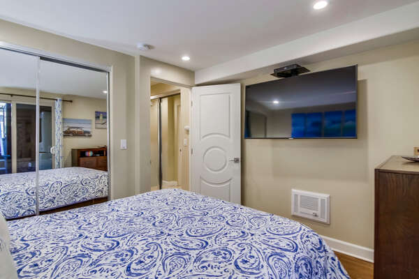 Master Bedroom with Queen bed and large all mounted TV.