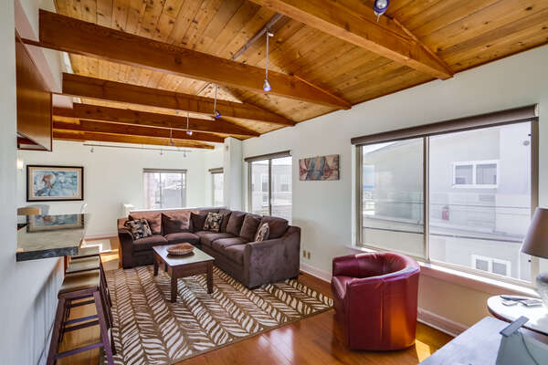 Living Room with Beam Ceiling