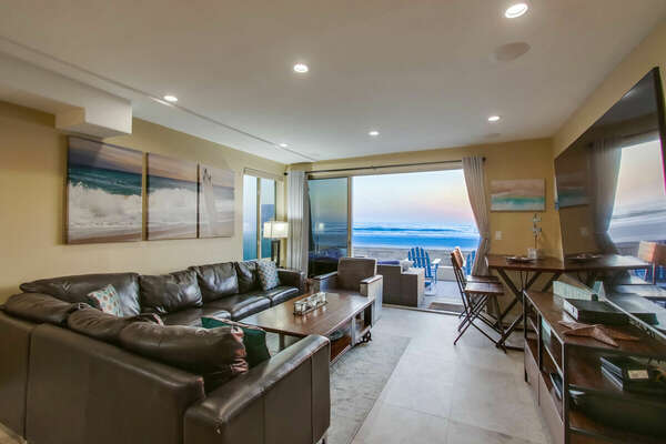Another angle of the living area, with a view of the ocean from the wide sliding glass door.