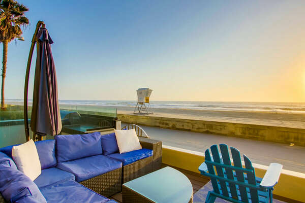 Sectional outdoor couch and patio chairs on the beachfront patio.