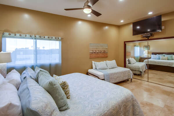 Master Bedroom Includes TV Mounted on Wall.