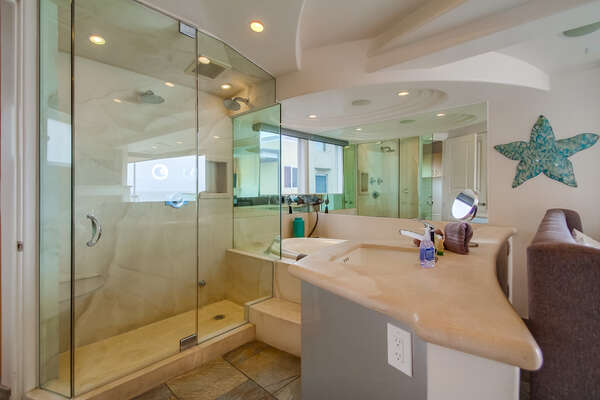 Master en suite bathroom with shower and jacuzzi