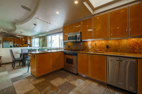 Large Kitchen Includes Plenty of Counter and Cabinet Space.
