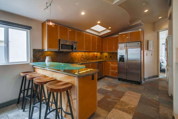 Fully Stocked Kitchen Includes Stainless Steel Appliances.
