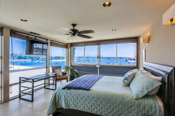 Master Bedroom on the Third Floor of this Mission Beach Rental House, with King bed and large windows.