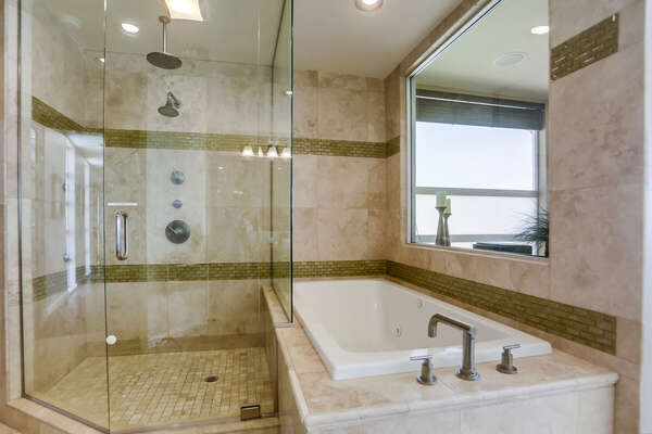 The luxury tub and walk in shower of the Master En-Suite Bath