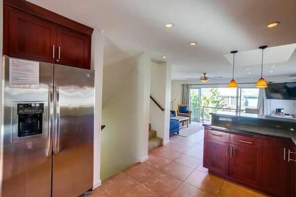 Image of Kitchen and Stairwell in Property.
