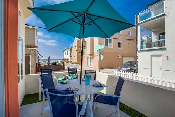 Outdoor Patio Dining Table Can Seat Four Guests.