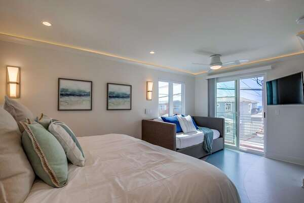 Bedroom Features Large Mounted TV.