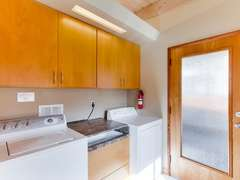 Laundry facilities in kitchen.