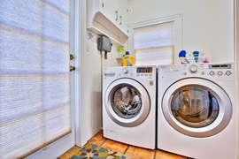 Washer and dryer off the kitchen.