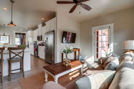 Back living room attached to kitchen.