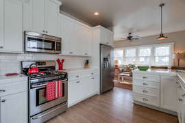 Large kitchen with stainless steel appliances.