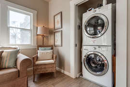 Washer and dryer in back living room.