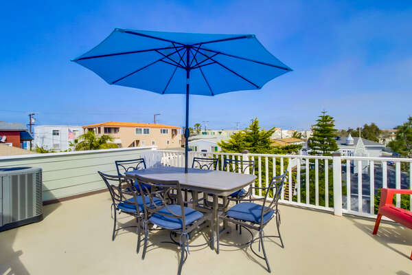 Upper level patio of this San Diego County Vacation Rental with covered table.